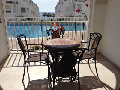 Photo for Fantastic apartment in Fuentes de Nerja overlooking the pool with UK TV and WiFi