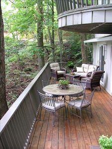 Front porch/deck with comfortable seating and dining. Gas grill (not pictured).