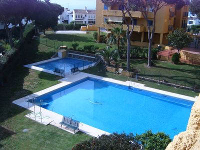 Photo for Spacious 3 bed apartment in gated community with mature gardens & full size pool