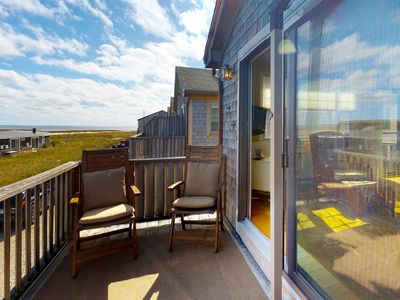 Photo for Colorful, inviting condo with private deck and views of the water