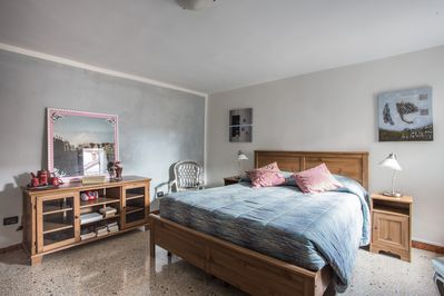 The bright and spacious bedroom with a very comfortable kingsize bed