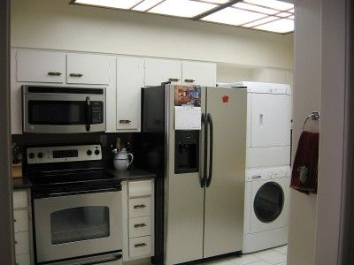 Kitchen has full size washer/dryer and refridge with ice maker in door.