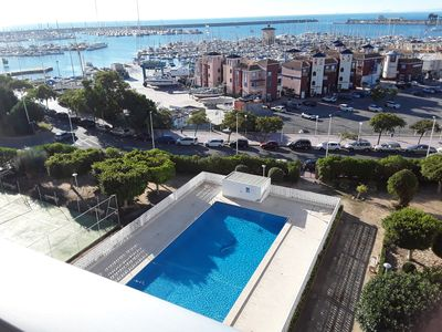 Amazing view from our balcony showing our  large pool & tennis court