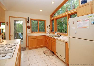 Fully equipped kitchen offers views of nature.