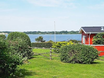 Photo for Cozy Holiday Home in Jutland with beautiful sea view