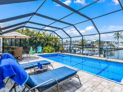 Photo for Leaping Lizard: 3 bed/2 bath Canal Front w/Screened Heated Pool! 2 Miles to AMI