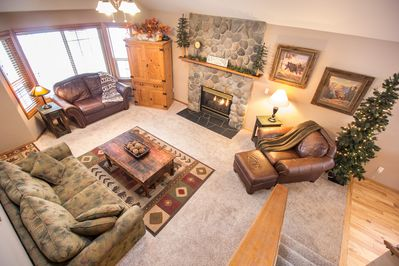 Living Room / River Rock Fireplace / HDTV / Quality Furnishings