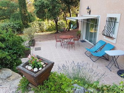 Photo for Garden level cottage under the parasol pines