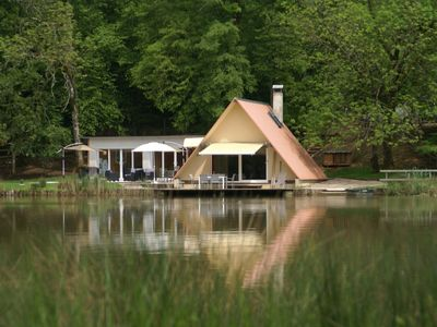 Photo for Unique holiday home by private lake, with swimming pool and jacuzzi on 2 hectare property