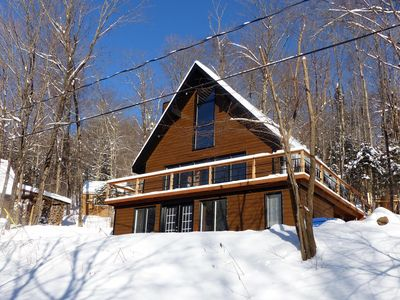 Photo for Wooden Chalet Facing the Ski Slopes / 30 minutes from Quebec City