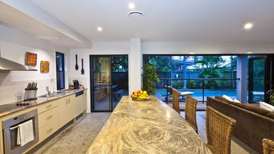 Cooking is a breeze in the large open-plan kitchen with polished concrete floors