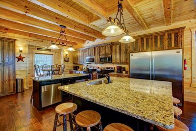 Kitchen - granite counters, 2 dishwashers, 2 microwaves, 2 stoves, and 2 ovens