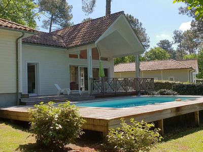 "Photo for WOODEN HOUSE ""OPALINE VILLA"", GOLF AREA, 6 PERS, HEATED POOL, QUIET"