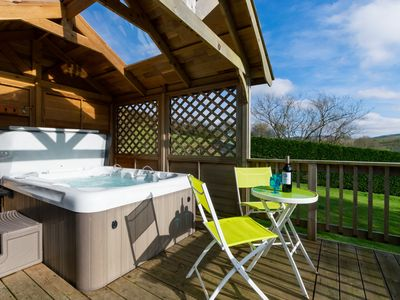 Photo for Cosy accommodation with sauna, wood burner and hot tub with views of beautiful Mid-Wales hills. Plen