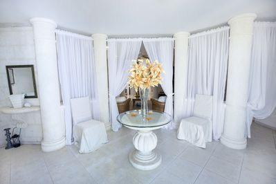 Coral stone foyer to welcome you to our villa