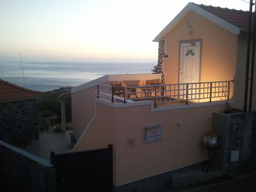 Holiday house with stunning views over mountains and the sea, large garden with barbecue