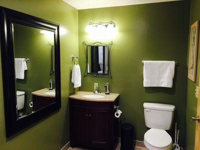 Large bathroom with dressing mirror.