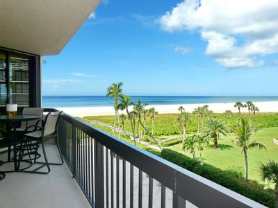 Photo for Tranquil beachfront condo w/ heated pool & hot tub