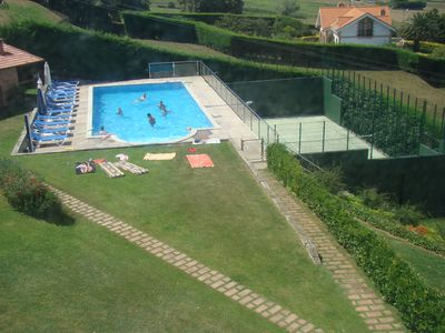 Photo for Luxury apartment with pool and tennis court. Front beach of Usil-Mogro