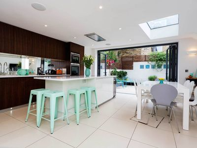 Photo for Great for Families! Spacious 4BR home with garden in lovely Fulham, by Veeve