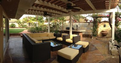 patio with wicker sofa sets, BBQ island with granite tile, fountain