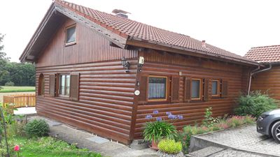 Photo for Warm detached log house with 2 terraces and large garden