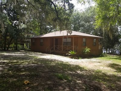 Lakefront private home with lots of parking space and a BBQ pavilion.