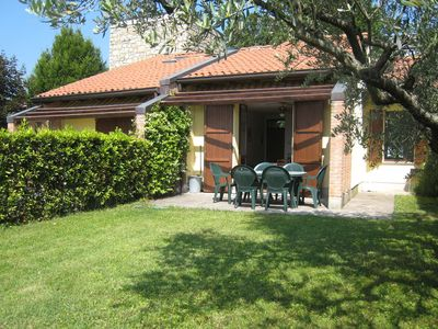 Photo for Semi-detached holiday home with comunal swimming pool and view at Lake Garda