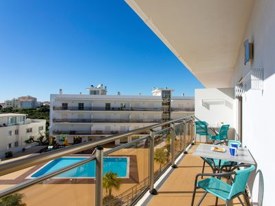 Photo for Apartment in Albufeira overlooking pool, with views, Wi-Fi & UK TV