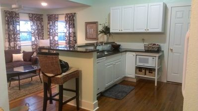 Kitchen has dishwasher, garbage disposal, microwave, gas oven and full fridge.