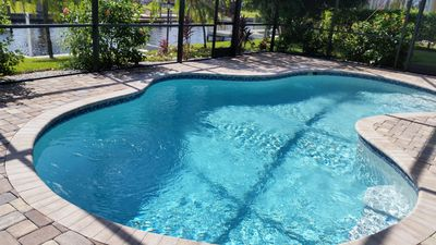 Photo for Cape Coral/Yacht Club/Salt Water Pool/Free-Wifi/HDTV/Direct River Access