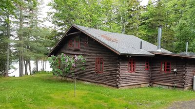 Photo for Cedar log cabin 80 ft off shore of peaceful Quimby Pond