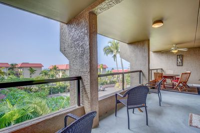 Spacious lanai with outdoor seating and side ocean view.