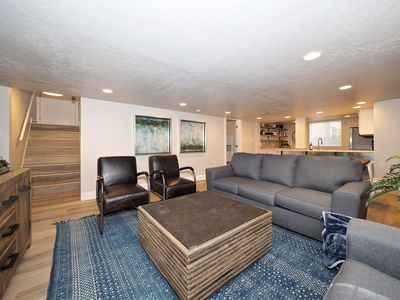 """Spacious Family Room with plenty of seating and a 65"""" Flat Screen TV"""