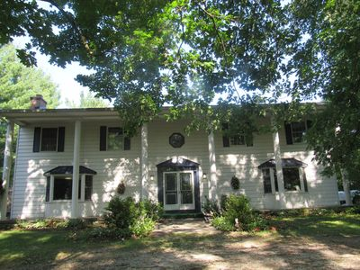 Photo for Southern Colonial on 10 country acres. 3K living space, 6BR, 2F/2H bath, pool