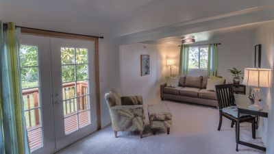 The living room is light and comfortable with HD TV and fireplace