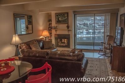 Kick back and relax in the love seats next to the fireplace