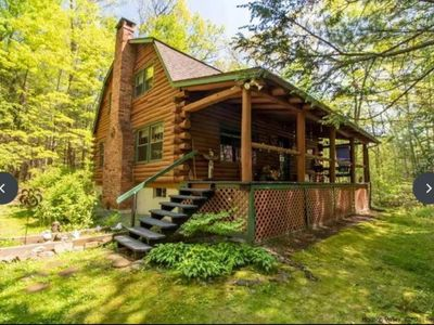 """Photo for A modern """"State of the Art"""" Log Cabin  nestled in a serene wooded property."""