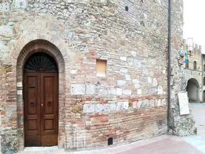 Photo for Cozy apartment right in the center on piazza del Duomo of San Gimignano