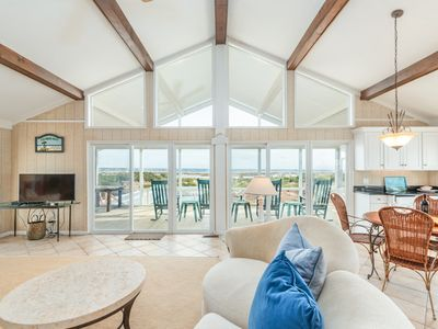Photo for Expansive, four-bedroom home w/ocean views, beach access, screened-in porch & outdoor shower.