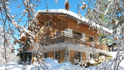 Photo for CHARMING FAMILY CHALET IN SWIMMING POOL WITH VIEWS OF THE COL DES ARAVIS