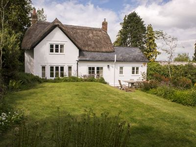 Photo for Benville Cottage is a 16th century thatched holiday cottage for 4 guests near Evershot, Dorset