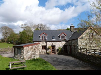 Photo for Traditional, dog-friendly Welsh cottage with lovely interior 2 miles from amenities of charming Dolg