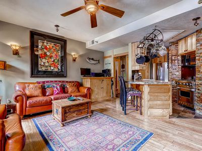 Photo for THE GRANDEUR CABIN CONDO ON MAIN.  BOOK EARLY FOR NEXT WINTER.  Walk to Town Lift from this beautiful, clean and cozy condo with a mountain flair.  High end finishes, huge TV.  Located in the heart of Historic Park City Main Street.  Don't miss this one!
