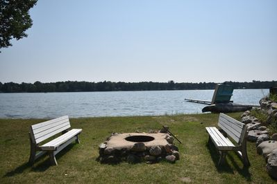Lower level....Family room walkout to firepit area right @ the beach on Fox Lake