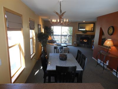 Dining Room and Living Room with sunny side views to Buffalo Mountain.