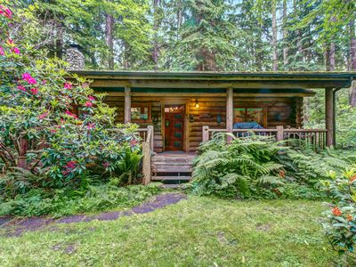 Photo for Dog-friendly log cabin surrounded by gorgeous woodlands with nearby lake!