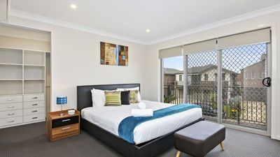 Photo for 4 Bdrm Modern Home, Sleeps 12, Great Value for Groups or Corporate Stays
