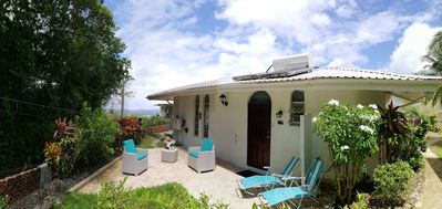 Photo for Detached West Coast Villa in quiet garden with shared pool & superb sea views
