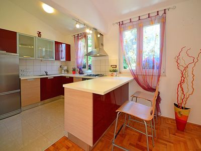 Photo for Apartment 1.3 km from the center of Opatija with Parking, Internet, Air conditioning, Balcony (113093)